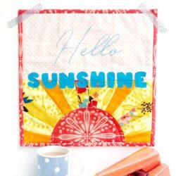Hello Sunshine Mini quilt on white wall