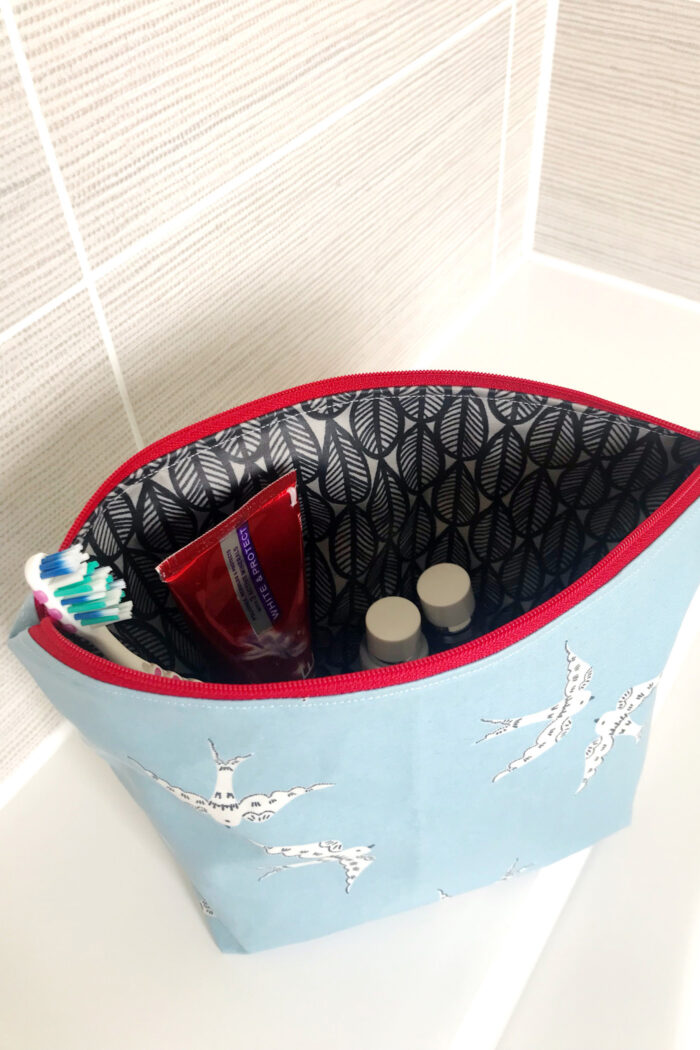 Inside of the laminated toiletry bag on bathroom counter