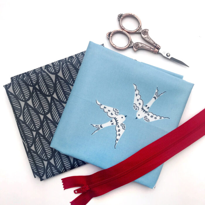 sewing supplies for toiletry bag on white background
