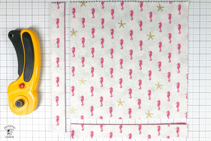 "10"" pre cut fabric squares on cutting mat"