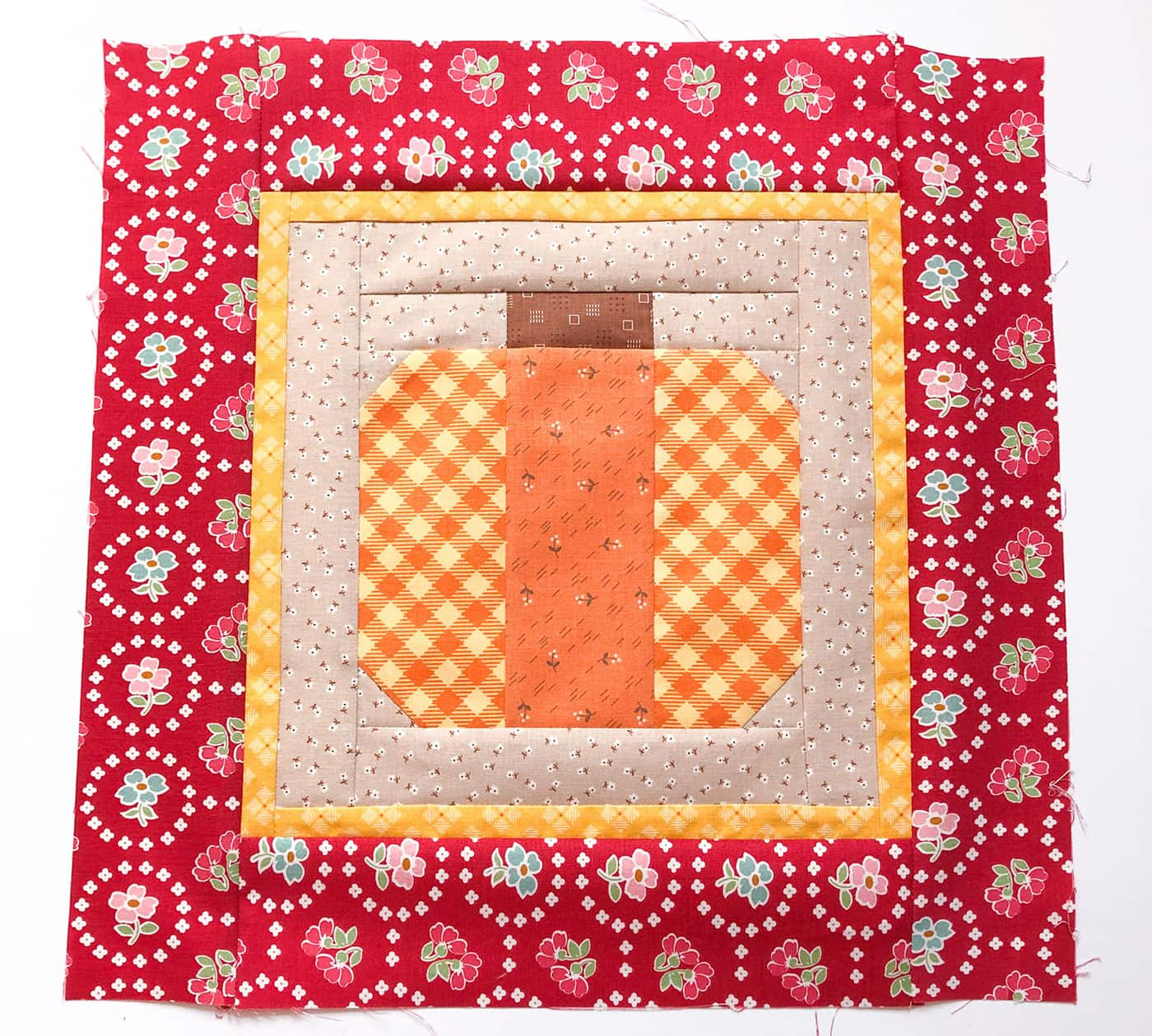 Pumpkin pillow assembly steps on white background