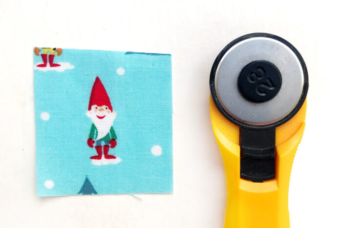 square of christmas fabric cut for pattern