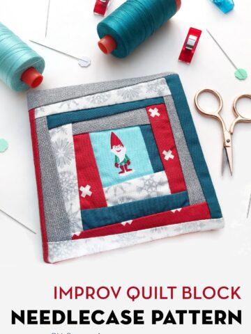Improv quilt block needle case on white table