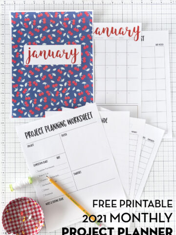 printed out planner pages on white grid cutting mat
