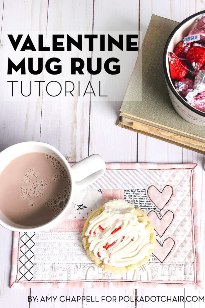 Valentine's Day mug rug on wood table with candy and cup of hot chocolate.