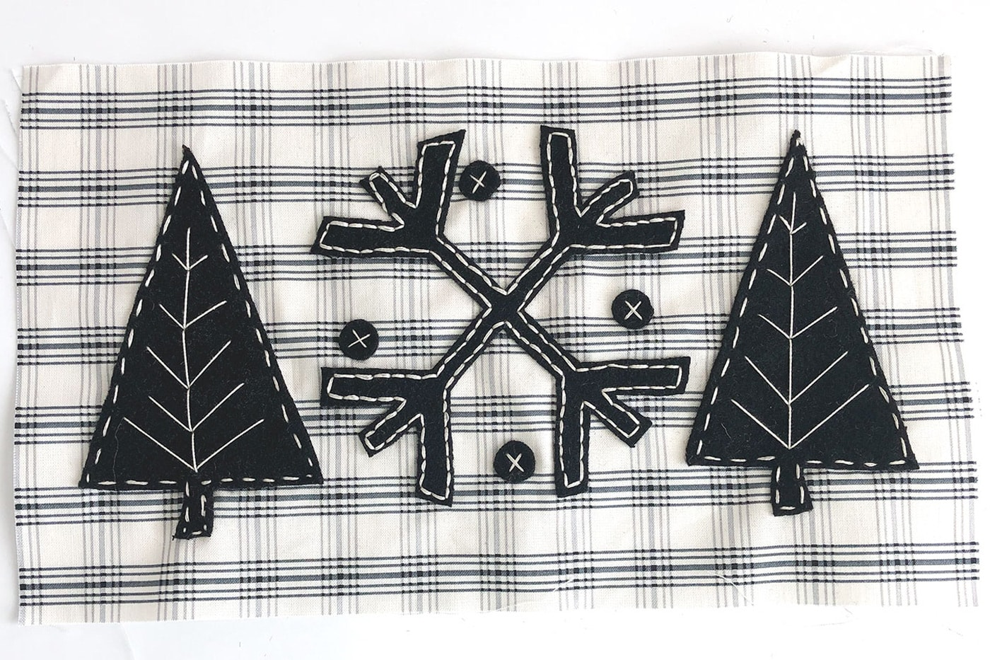 finished applique on black and white fabric