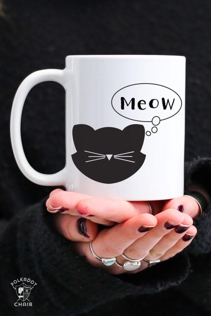 meow mug white mug with black text