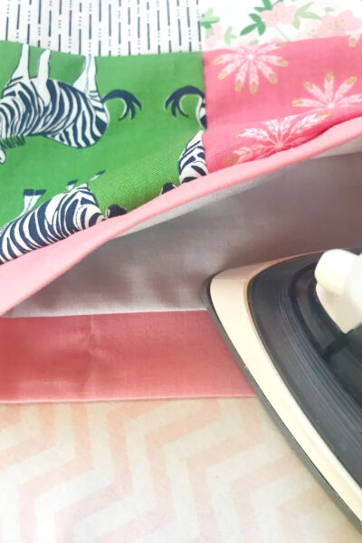 iron and bag casing on ironing board