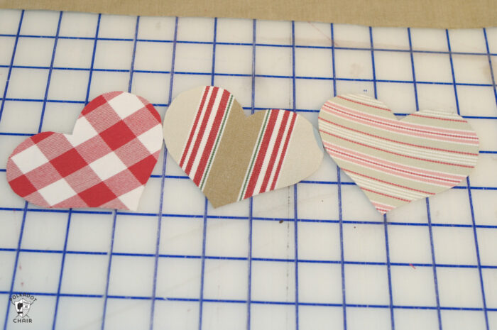 cut out hearts for pillow project on white cutting mat