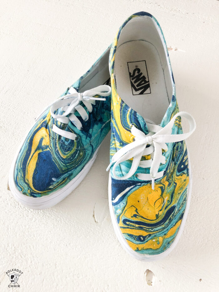 blue, yellow and aqua hydro dipped vans on white table