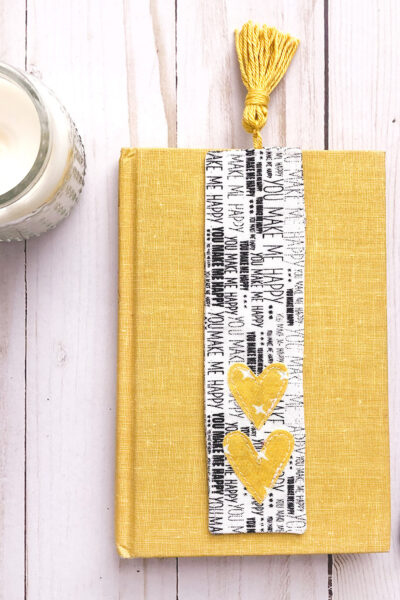 black and white fabric bookmark on yellow book
