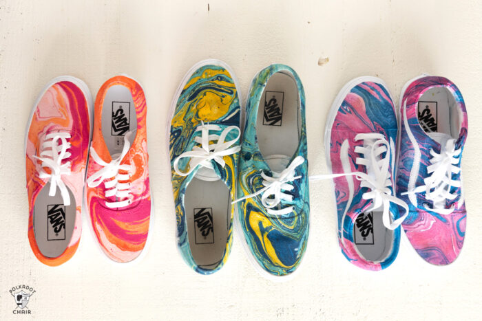 3 pair of hydro dipped vans on cream table top