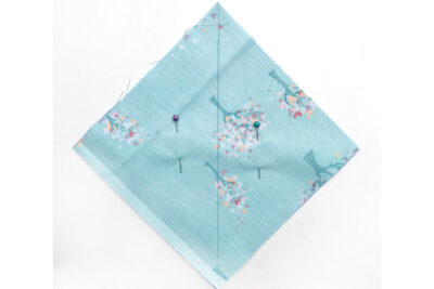 Blue square of fabric on white table