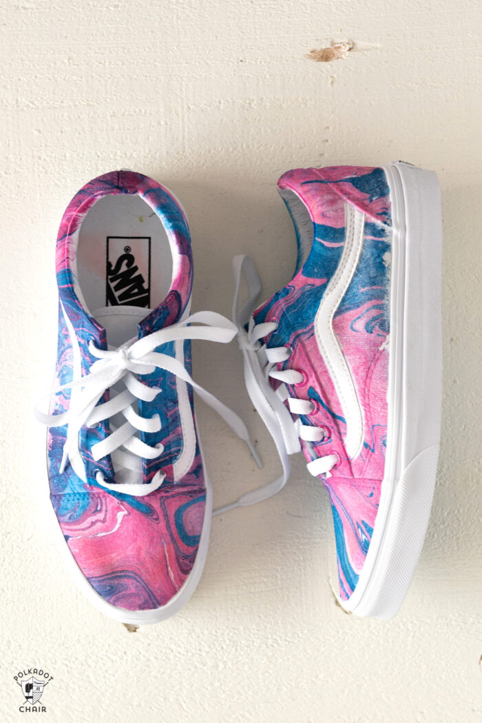 navy and pink vans on white table