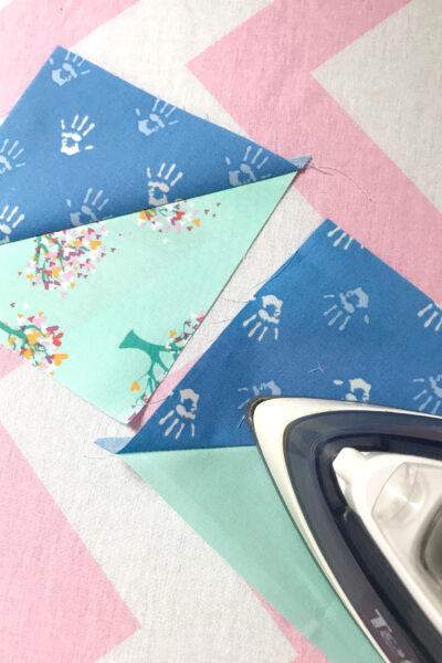 iron and quilt blocks on ironing board