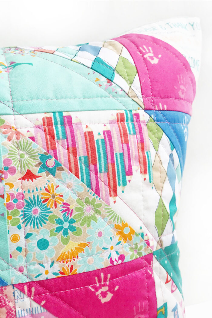 close up of quilted pillow on white background