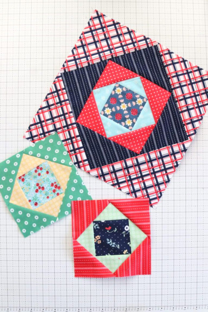 finished quilt blocks on white cutting mat