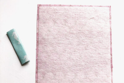 pink fabric wrong side out on white tabletop
