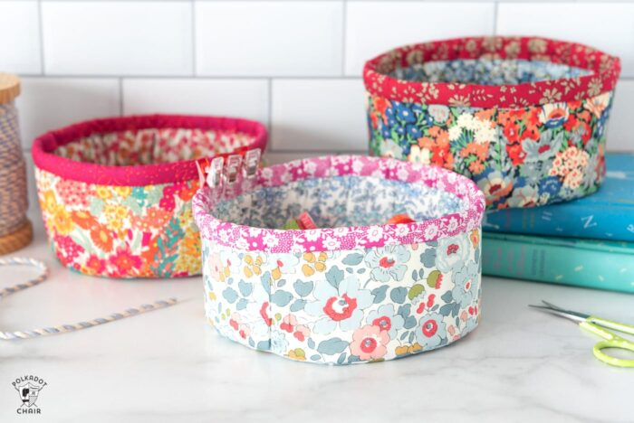 round fabric baskets on white countertop with books