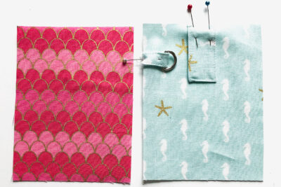 pink and aqua rectangles cut out on white table