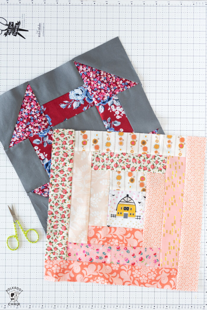 log cabin and churn dash quilt block on white cutting mat