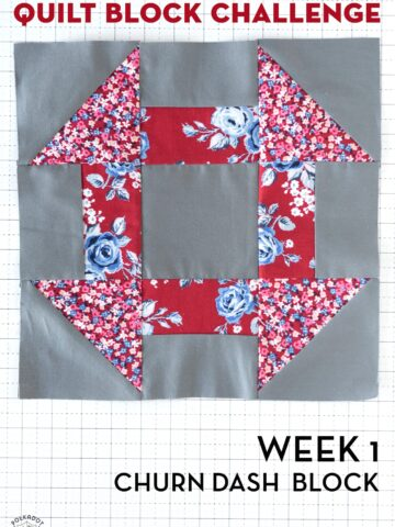 gray and red churn dash quilt block on white cutting mat