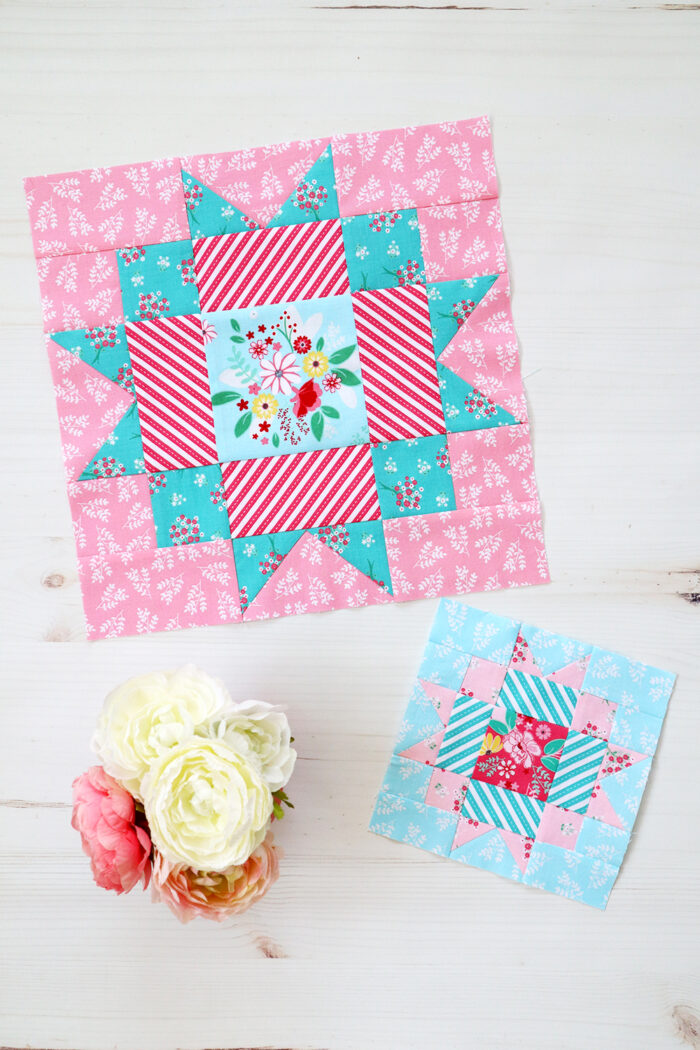 pink and blue quilt blocks on white table
