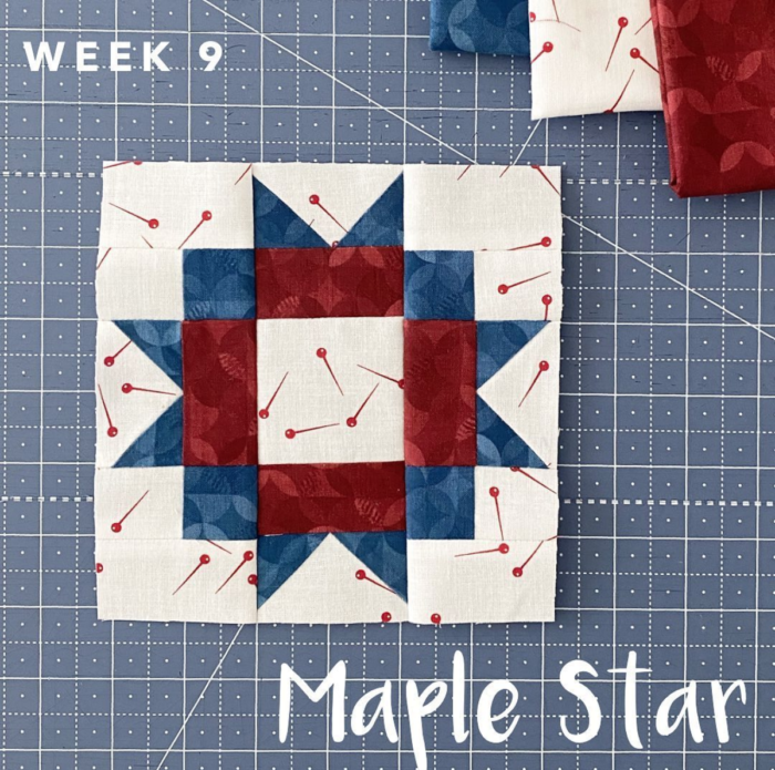 Red white and blue quilt block on blue cutting mat