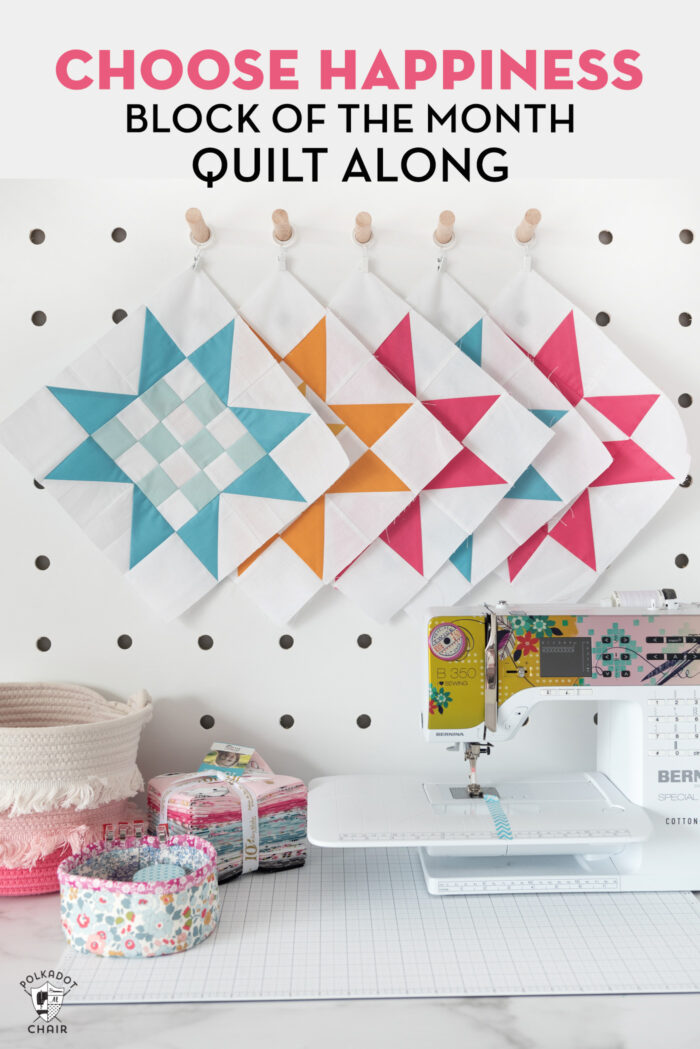 quilt blocks pinned to peg board with sewing machine on table