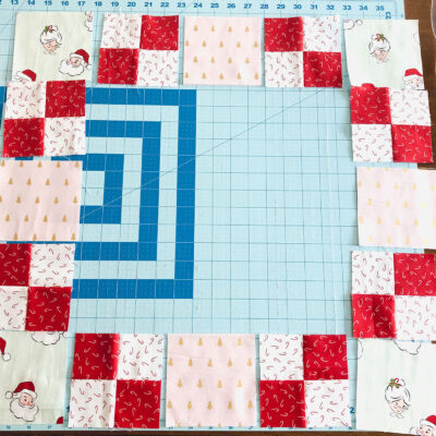 patchwork table topper pieces on cutting mat