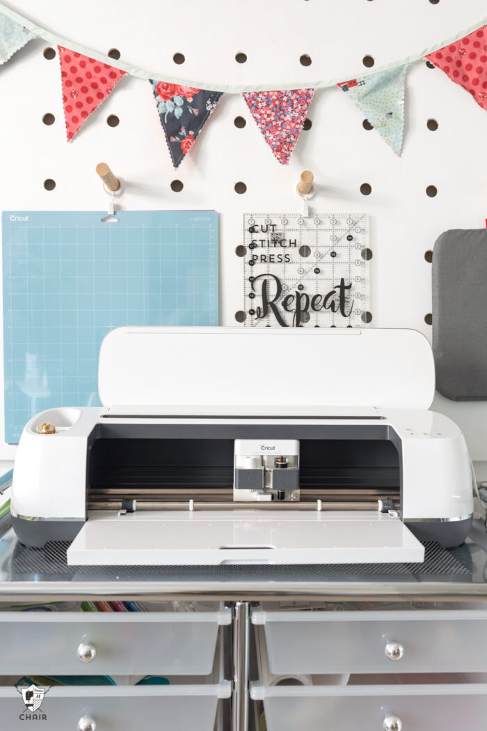 Cricut maker in front of peg wall