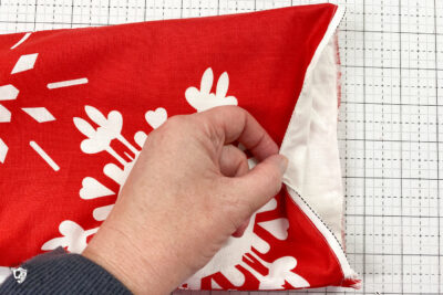 christmas stockings in progress on white cutting mat
