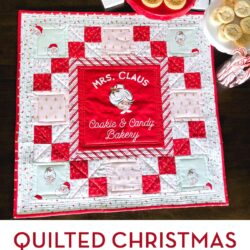 red white and pink christmas table topper with cookies on brown table