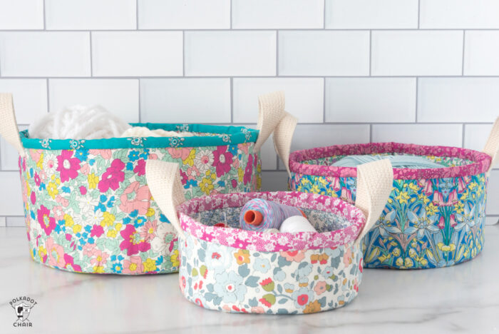 nesting fabric baskets on white marble table