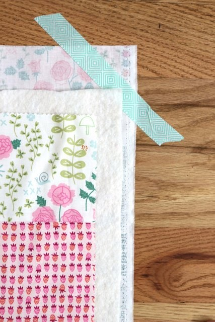 basted quilt on floor