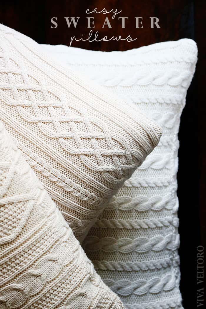 3 sweater pillows on wood floor