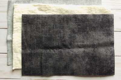 3 colors of gray fabric on white table