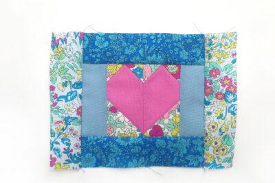 heart quilt block on white table