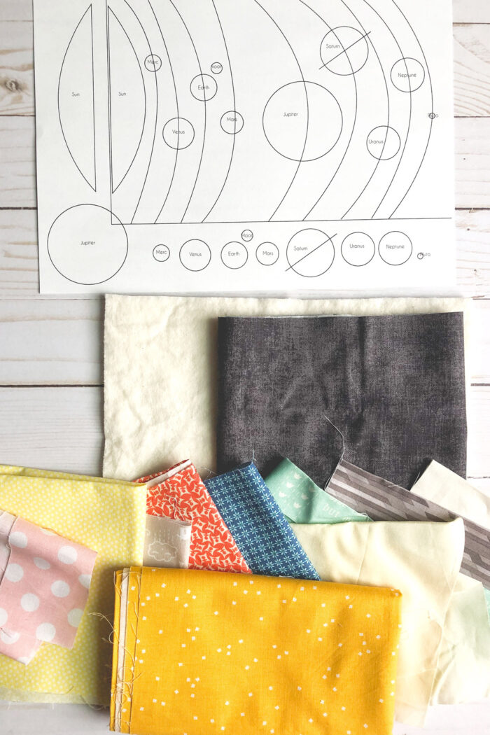 solar system fabric supplies and pattern on white table