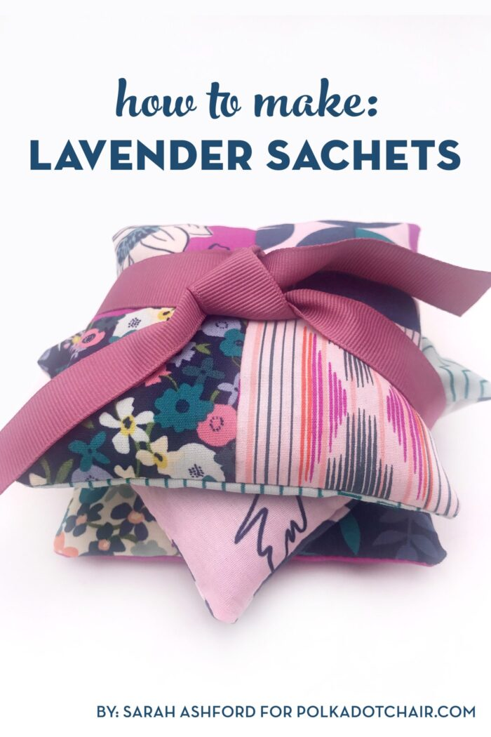 stack of lavender sachets tied up with ribbon on white table