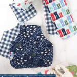 blue baby burp cloths on white marble countertop