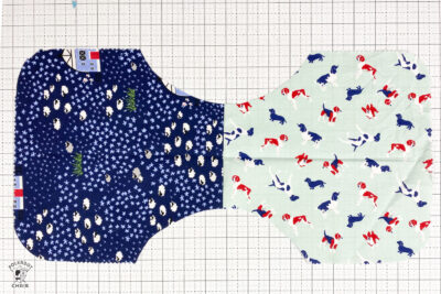 burp cloth pieces cut out on white cutting mat