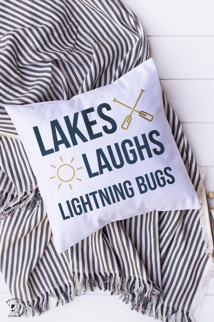 white pillow with blue lettering