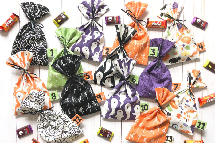multi colored halloween treat bags on table