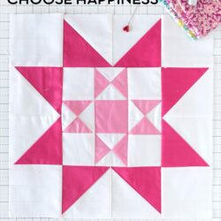 Colorful quilt block on white cutting mat