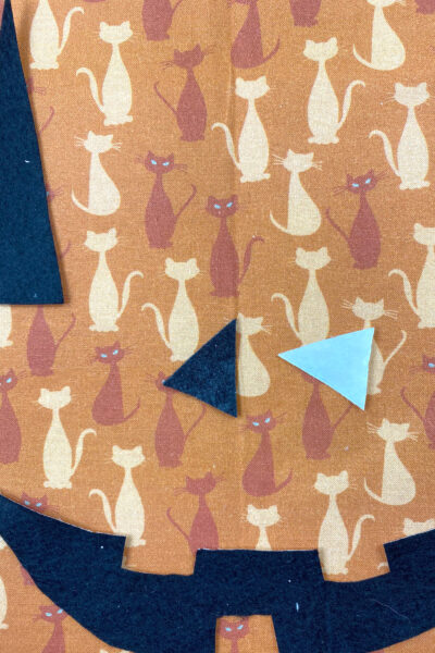 black triangles cut out on halloween fabric