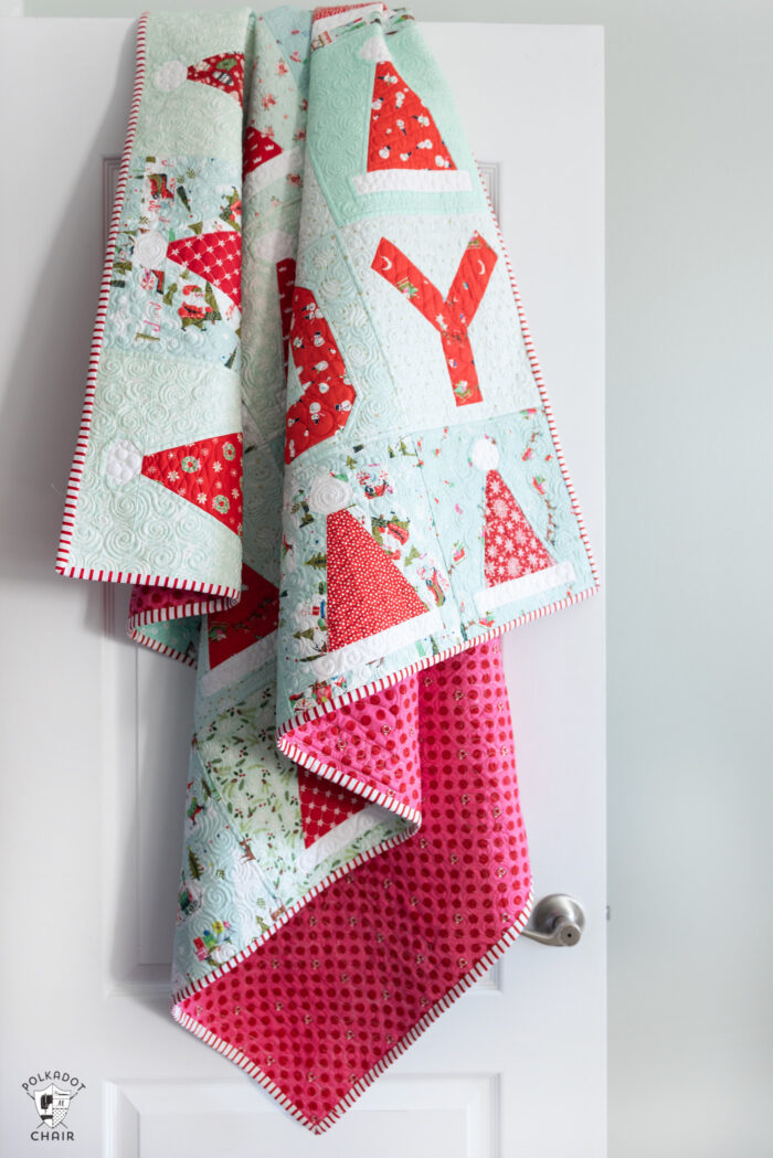 santa hat quilt hanging on door