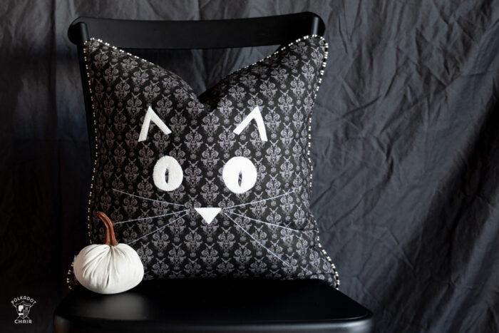 halloween pillows on black chair