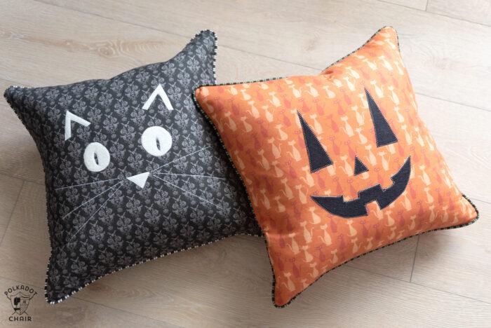 halloween pillows on wood floor