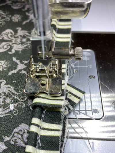 close up of piping under presser foot